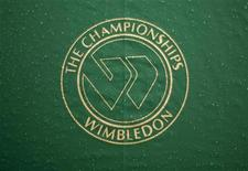 <p>The Wimbledon logo is seen on an umbrella at centre court as rain delays the quarter-finals match between Roger Federer of Switzerland and Mario Ancic of Croatia at the Wimbledon tennis championships in London July 2, 2008. REUTERS/Kevin Lamarque</p>