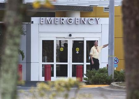 A man stands outside the emergency room of Health Central Hospital in Occoee, Florida December 8, 2009. REUTERS/Scott Audette