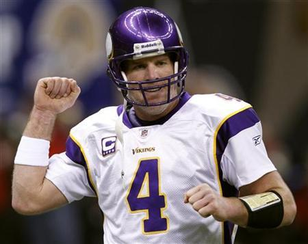 Minnesota Vikings quarterback Brett Favre celebrates a touchdown against the New Orleans Saints in the third quarter of the NFL NFC Championship football game in New Orleans, Louisiana, January 24, 2010. REUTERS/Jeff Haynes