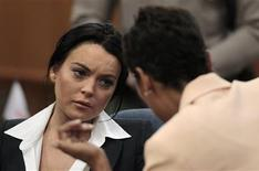 <p>Lindsay Lohan listens to attorney Shawn Chapman Holley in the courtroom during a probation status hearing in Beverly Hills May 24, 2010. A REUTERS/Jae C. Hong/Pool</p>