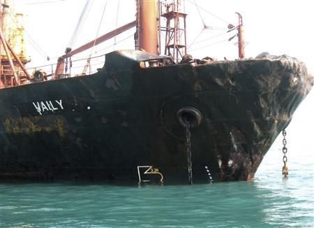 A view of the damaged MV Waily, a bulk carrier registered in St Vincent and the Grenadines, after a collision with a Malaysian flagged oil tanker in waters between Malaysia and Singapore May 25, 2010. REUTERS/Malaysian Maritime Enforcement Agency/Handout