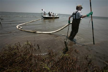 Scientist Douglas Inkley of the National Wildlife Federation pulls a broken oil boom on an island impacted by the Deepwater Horizon oil spill in the Barataria Bay, Louisiana May 24, 2010. REUTERS/Lee Celano