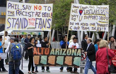 People protest Arizona's new immigration law outside the Staples Center prior to the start of Game 1 of the NBA Western Conference final playoff series between the Los Angeles Lakers and the Phoenix Suns in Los Angeles May 17, 2010. REUTERS/Danny Moloshok