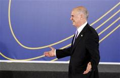 <p>Greece's Prime Minister George Papandreou gestures before being greeted by Spain's Prime Minister Jose Luis Rodriguez Zapatero at the start of the European Union-Latin American summit in Madrid May 18, 2010. REUTERS/Sergio Perez</p>