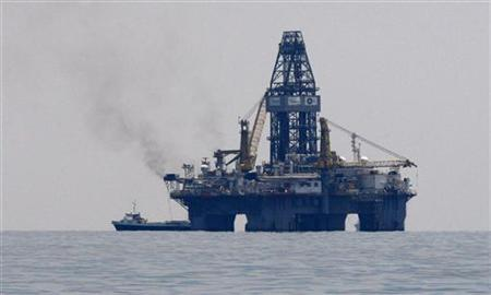 Development Driller III, which is drilling a second relief well, floats on the surface near the site of the BP oil spill approximately 42 miles off the coast of Louisiana May 18, 2010. The oil company is hoping to have the well in operation in 90 to 120 days. REUTERS/Hans Deryk
