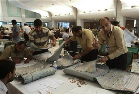 Workers from Iraq's Independent High Electoral Commission (IHEC) recount parliamentary election ballots in Baghdad May 14, 2010. REUTERS/Mohammed Ameen