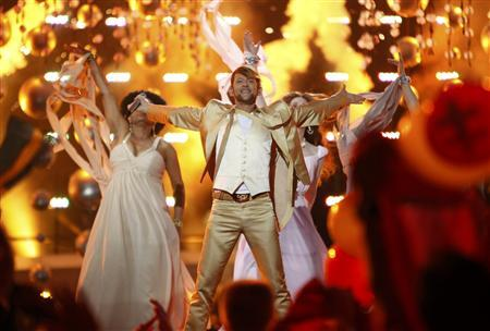 Michael von der Heide from Switzerland performs his song ''Il Pleut de L'Or'' during semi-final two of the Eurovision Song Contest in Oslo, May 27, 2010. REUTERS/Bob Strong