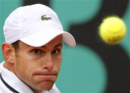 Andy Roddick of the U.S. eyes the ball during his match against Blaz Kavcic of Serbia during the French Open tennis tournament at Roland Garros in Paris May 27, 2010. REUTERS/Regis Duvignau
