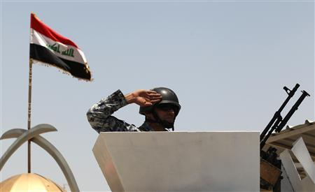 A newly-graduated policeman salutes during a graduation ceremony in Baghdad May 27, 2010. REUTERS/Mohammed Ameen