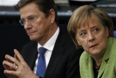 <p>German Chancellor Angela Merkel (R) and Foreign Minister Guido Westerwelle attend a debate on the euro rescue package in the Bundestag, the lower house of parliament, in Berlin May 21, 2010. REUTERS/Thomas Peter</p>