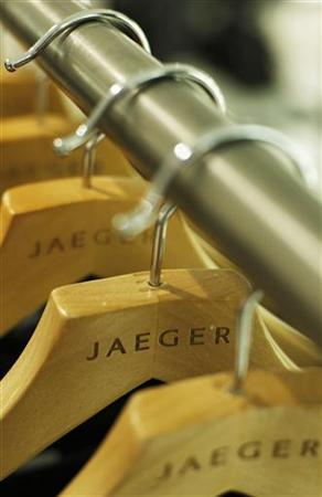Clothes hang on coat hangers in a Jaeger store in London September 14, 2009. REUTERS/Luke MacGregor