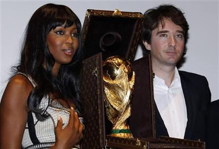 Model Naomi Campbell and Antoine Arnault, Louis Vuitton Director of Communications, pose with the World Cup trophy which is presented in its Louis Vuitton travelling case in Paris, June 1, 2010. REUTERS/Jacky Naegelen