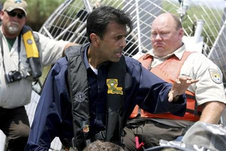 Louisiana Governor Bobby Jindal and other officials explain to the media the damage the BP oil spill has already inflicted on the delicate coastline in Pass A Loutre near Venice, Louisiana May 26, 2010. REUTERS/Sean Gardner
