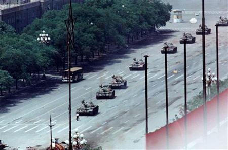 A man stands passively to block a column of army tanks on Changan Avenue east of Tiananmen Square in Beijing in this June 5, 1989 file photo. REUTERS/Arthur Tsang/Files