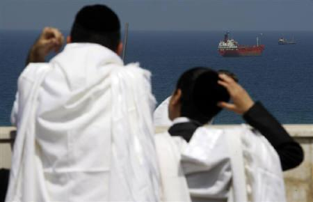 Israel orthodox Jews look at the Mediterranean sea at the port of Ashdod June 5, 2010. he Israeli navy boarded another aid ship bound for Gaza on Saturday. REUTERS/Baz Ratner