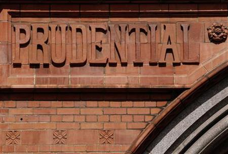 Raised lettering in the brickwork of the former Prudential Assurance building casts shadows in the City of London May 28, 2010. REUTERS/Luke MacGregor