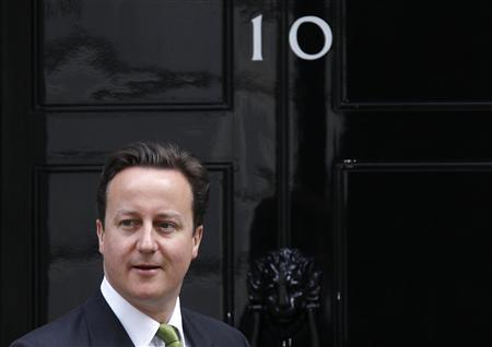 Prime Minister David Cameron waits outside his official residence of 10 Downing Street in central London June 7, 2010. REUTERS/Stefan Wermuth