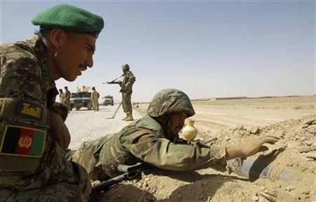 Afghan National Army (ANA) soldiers take part in an improvised explosive device (IED) detection training course at Camp Hero in Kandahar province, southern Afghanistan in this June 3, 2010 file photo. REUTERS/Denis Sinyakov