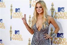 <p>Lindsay Lohan arrives at the 2010 MTV Movie Awards in Los Angeles, June 6, 2010. REUTERS/Danny Moloshok</p>