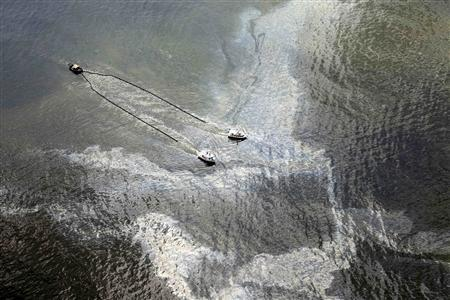 Skimmer boats pull booms through the oil from the Deepwater Horizon wellhead that sits on top of the water in Barataria Bay, Louisiana just off the Gulf of Mexico June 8, 2010. REUTERS/Jose-Luis Magana/Greenpeace/Handout