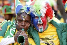 <p>Soccer fans cheer while awaiting the start of the opening ceremony of the 2010 World Cup at Soccer City stadium in Johannesburg June 11, 2010. REUTERS/Siphiwe Sibeko</p>