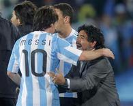 <p>Argentina's coach Diego Maradona celebrates with Lionel Messi at the end of the the 2010 World Cup Group B soccer match at Ellis Park stadium in Johannesburg June 12, 2010. REUTERS/Enrique Marcarian</p>