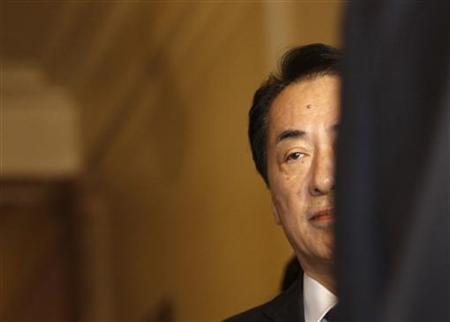 Japan's new Prime Minister Naoto Kan enters the lower house hall to deliver his keynote speech in Tokyo June 11, 2010. REUTERS/Issei Kato