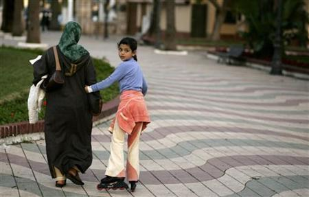 A Muslim woman and her daughter walk in Melilla, Spain February 21, 2008. REUTERS/Rafael Marchante