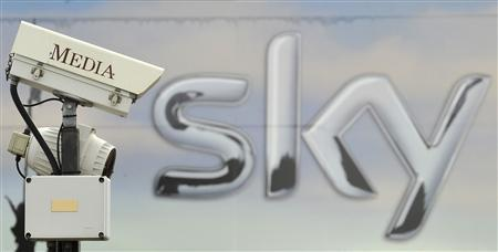 A CCTV camera points past a Sky logo in London, June 15, 2010. REUTERS/Toby Melville