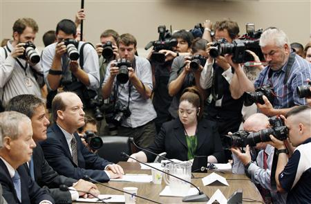 Members of the media photograph U.S. oil company executives before they testify on the BP oil spill in the Gulf of Mexico during a House Energy and Commerce hearing on Capitol Hill, June 15, 2010. REUTERS/Larry Downing