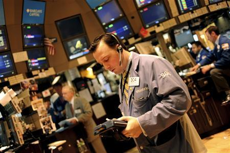 A trader works on the floor of the New York Stock Exchange shortly after the opening bell in New York, June 14, 2010. REUTERS/Keith Bedford