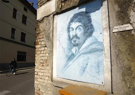 A painting of of Baroque artist Michelangelo Merisi, known as Caravaggio, is seen on a wall near the house where Caravaggio was born in the northern Italian town of Caravaggio March 8, 2010. REUTERS/Alessandro Garofalo