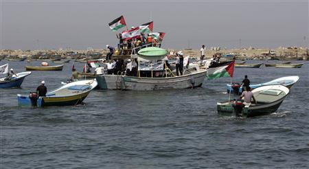Palestinians ride boats in a preparation for the arrival of Lebanon-Gaza flotilla at Gaza Seaport June 21, 2010. REUTERS/Ismail Zaydah