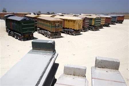 Israeli trucks loaded with cereal park outside Karni Crossing between Israel and the Gaza Strip near Kibbutz Nahal Oz June 21, 2010. REUTERS/Amir Cohen