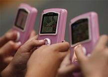 "<p>Girls play with ""My Life"" toys at the Dream Toys exhibition in London October 15, 2008. REUTERS/Stephen Hird</p>"