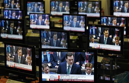 Chancellor George Osborne is shown making his budget speech on television screens in an electrical store in Edinburgh, June 22, 2010. REUTERS/David Moir