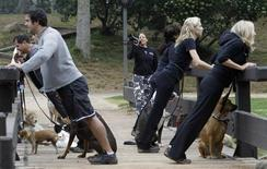 <p>Founder Jill Bowers shouts instructions through a megaphone to owners and their dogs as they work out during the Thank Dog! Bootcamp fitness class in Burbank, California, June 18, 2010. REUTERS/Mario Anzuoni</p>