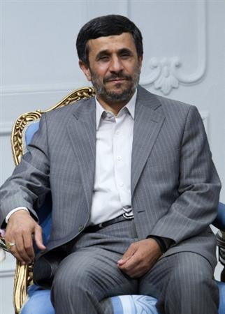 Iran's President Mahmoud Ahmadinejad attends an official meeting with Syria's Vice President Farouq al-Shara in Tehran June 22, 2010. REUTERS/Raheb Homavandi