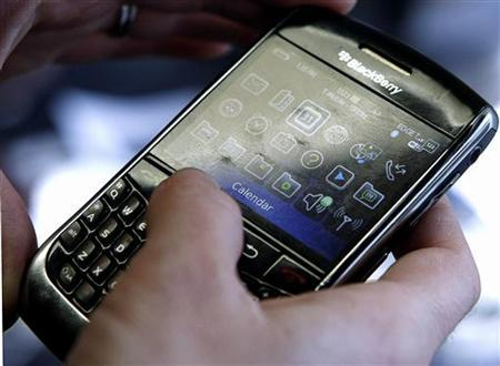 A BlackBerry smartphone user is pictured checking its Calendar in Washington, March 30, 2010. REUTERS/Stelios Varias