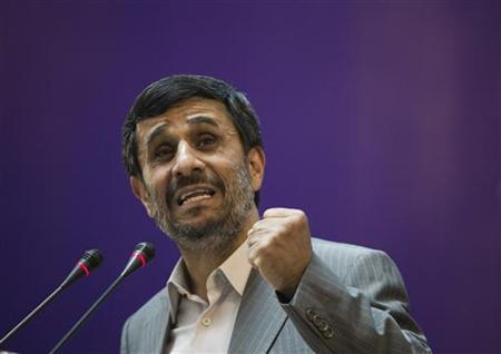 EDITORS' NOTE: Reuters and other foreign media are subject to Iranian restrictions on leaving the office to report, film or take pictures in Tehran. Iranian President Mahmoud Ahmadinejad gestures while speaking during the opening of the International Conference of Islamic World Publishers in Tehran June 20, 2010. REUTERS/Morteza Nikoubazl