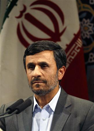Iranian President Mahmoud Ahmadinejad listens during the reading of prayers before he speaks during a news conference in Tehran June 28, 2010. REUTERS/Caren Firouz