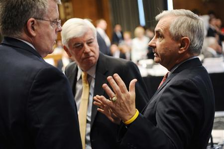 Senate Banking Committee Chairman Christopher Dodd (D-CT) (C) and Senator Jack Reed (D-RI) (R) talk during a recess from a committee conference on Wall Street reform to hammer out sweeping changes in financial regulation legislation on Capitol Hill, in Washington June 24, 2010. REUTERS/Jonathan Ernst