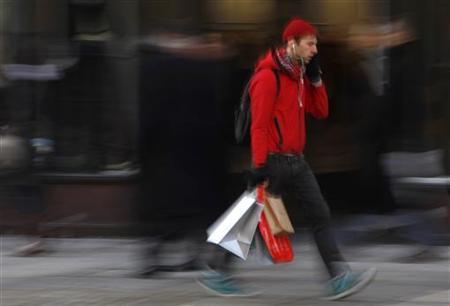A shopper walks down a street in London December 18, 2009. REUTERS/Stefan Wermuth