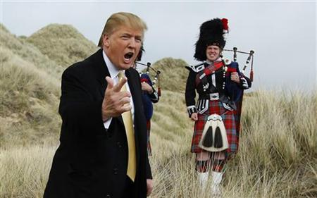 U.S. property mogul Donald Trump gestures during a media event on the sand dunes of the Menie estate, the site for Trump's proposed golf resort, near Aberdeen, north east Scotland May 27, 2010. REUTERS/David Moir