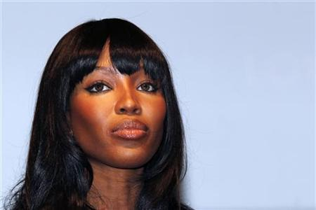 Model Naomi Campbell attends the presentation of the Louis Vuitton luxury travelling case for the World Cup trophy in Paris June 1, 2010. REUTERS/Jacky Naegelen