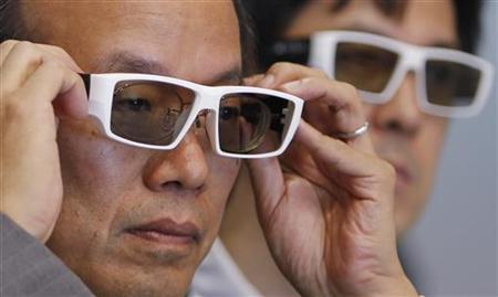 Visitors look through 3D glasses at the 3D and Virtual Reality Expo in Tokyo June 23, 2010. REUTERS/Yuriko Nakao