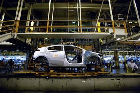 The first pre-production Chevrolet Volt rolls down the assembly line at the Detroit-Hamtramck manufacturing plant in Detroit March 31, 2010. REUTERS/John F. Martin/Handout