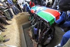 <p>Members of Sudan-born NBA star Manute Bol's family and locals lower his casket into the ground during his funeral in the town of Turalei in Warap state, southern Sudan, July 4, 2010. REUTERS/Mohamed Nureldin Abdallah</p>