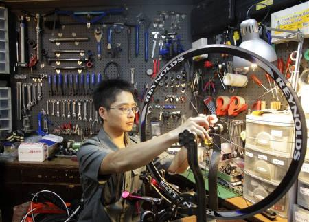 A man fixes a bicycle, part of the items included in the economic cooperation framework agreement (ECFA), at a shop in Taipei, June 29, 2010. REUTERS/Pichi Chuang