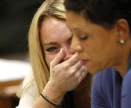 <p>Actress Lindsay Lohan reacts beside her attorney Shawn Chapman Holley (R) as Judge Marsha Revel rules that Lohan had violated her probation on a 2007 drunken driving charge in Beverly Hills, California July 6, 2010. REUTERS/David McNew/Pool</p>